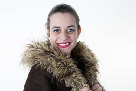 gingerish: Closeup portrait of attractive young woman wearing warm fur coat in winter.