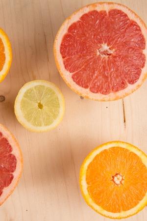 sharpness: Slices of orange, lemon, grapefruit on wooden background Close up, small depth of sharpness Stock Photo
