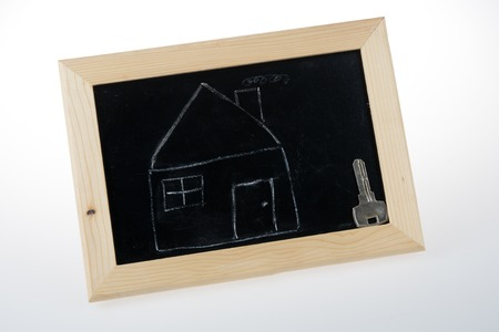 fulfilment: sketch of house and key on the blackboard Stock Photo