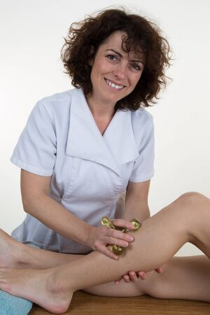 knee bend: Physiotherapist checking patients leg on a mat in bright room