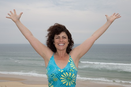 bliss: Happiness bliss freedom concept. Woman happy smiling joyful with arms up