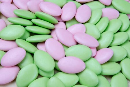 eastertime: Green and light pink coated chocolate, Easter sugar coated almonds or chocolate