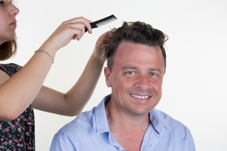 beauty parlour: Man with hairdresser making haircut at a beauty parlour. Stock Photo