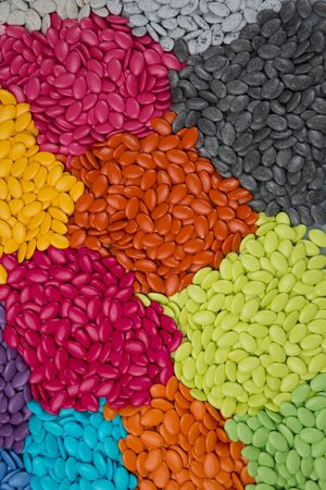 dragees: Plenty of candy dragees, colorful chocolate on a background Stock Photo