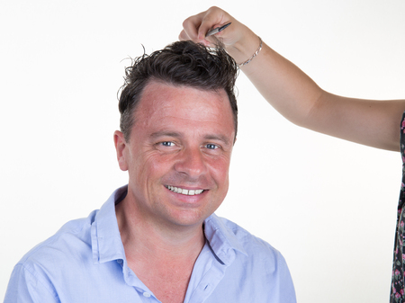 coiffeur: Man with hairdresser making haircut at a beauty parlour. Stock Photo