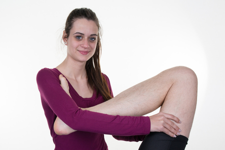 therapeutic massage: Real professional female masseur giving therapeutic massage to mans legs