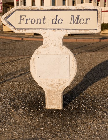 generic location: Street sign written sea front indicate the way Stock Photo