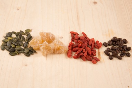 seeds coffee: Goji berries, seeds, coffee, ginger, on wooden table.