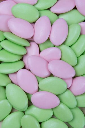dragees: Green and pink easterwedding chocolate dragees isolated on white background Stock Photo