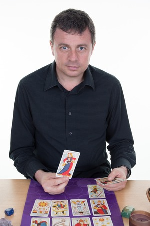 telepathy cards: Male Fortune teller using tarot cards on the table Stock Photo