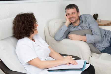 terapia psicologica: Image of happy male during psychological therapy Foto de archivo