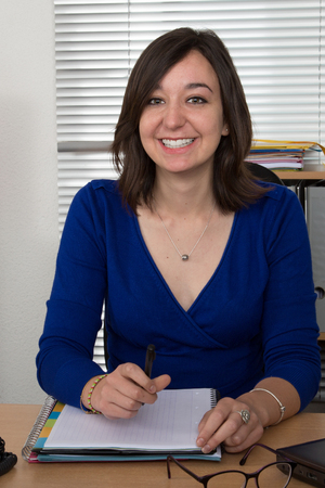 sitting pretty: Portrait of a pretty secretary sitting at her desk and smiling