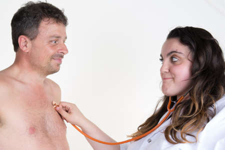 auscultate: Doctor female auscultating patient by stethoscope isolated on a white