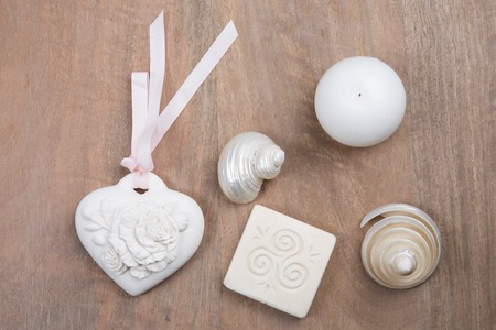 beachcombing: Wooden background with sea shells and hearts
