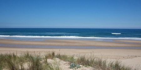 ocea: Panoramic view of coastline and beach with a blue sky. Stock Photo