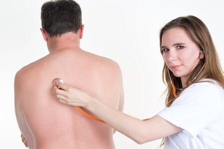 doctor examine: Female doctor Examine Patients Back With orange Stethoscope