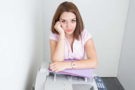 copy machine: Office womans hand pressing buttons on a copy machine