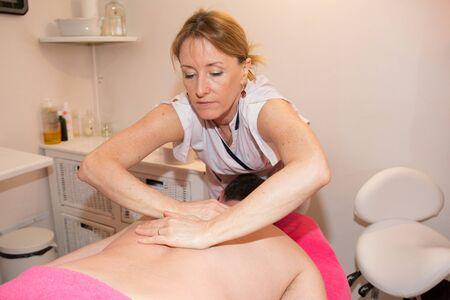 rubdown: Man having a massage in a wellness center