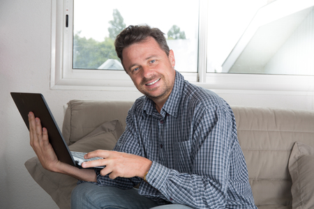 telework: Handsome businessman working from home