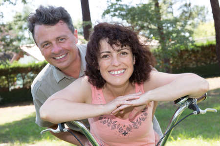 active adult community: Happy girl and boy standing on boke happy together . Outdoors