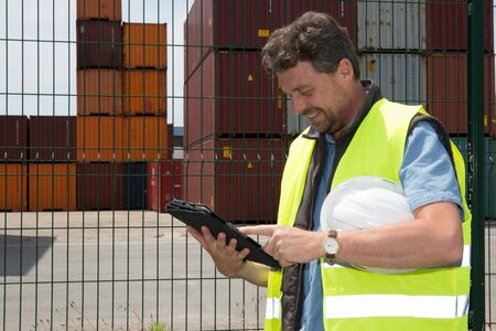 docker: View of an attractive docker using a tablet at work