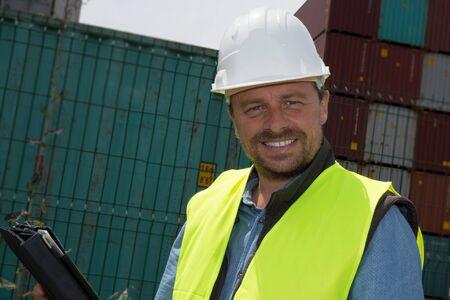 cb: Man Logistics manager at container transhipment plant, with an electronic tablet Stock Photo