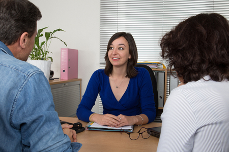 adviser: Happy couple meeting financial adviser for investment at office