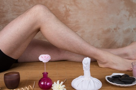 bodypart: Woman who takes care of her legs at spa center Stock Photo
