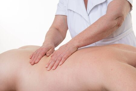 healing touch: Healing touch of therapist hands on back of man