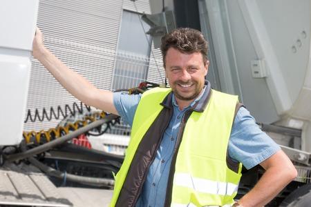 Happy truck driver smiling at the camera Reklamní fotografie