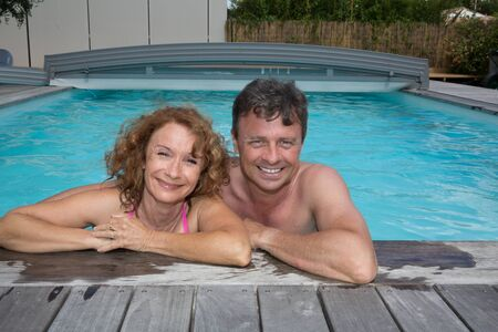 30 years old married couple: Happy and lovely couple in private swimming pool