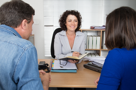 formations: Couple sitting in meeting making investment at desk