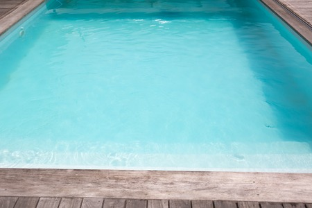 inground: Outdoor in ground residential swimming pool in backyard Stock Photo