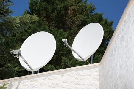 Satellite dish antennas under a blue sky