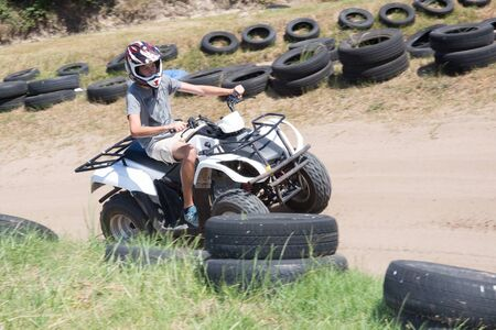 quad: Man or young boy is driving a quad Stock Photo