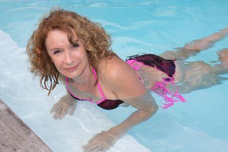 preety: Preety middle aged woman in bikini in pool