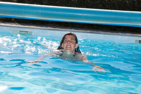 thalasso: Cheerful and happy woman in swimming-pool