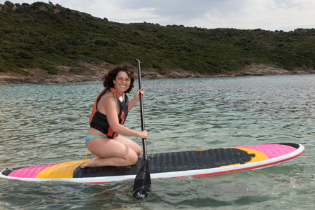 boarder: Stand up paddle boarder finishing a long workout on at the sea