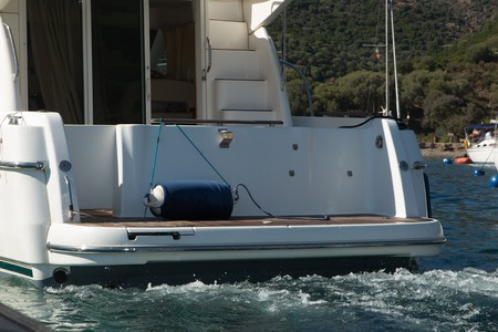 furled: View of rear section of a yacht Stock Photo