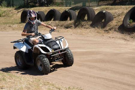 quad: Man driving quad bike enjoying the ride