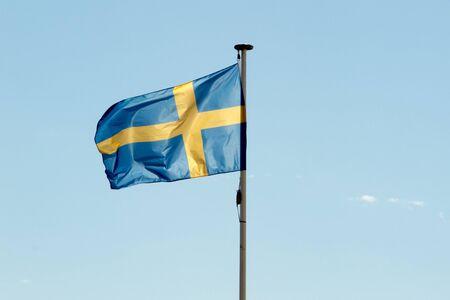 Flag of Sweden against a deep blue sky