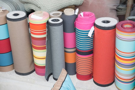 multy: Colorful fabric rolls. Focus on front part of a rolls