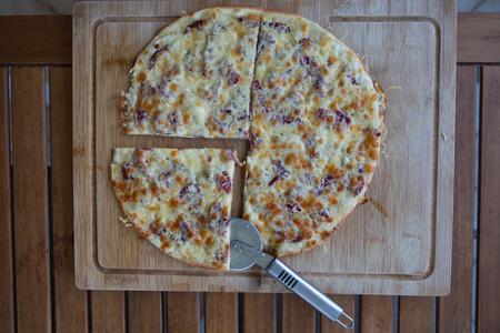 chorizo: Rustic stone backed pizza with chorizo salami Stock Photo