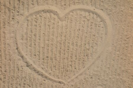 sand drawing: Heart on the beach in the sand drawing