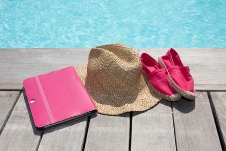 swim shoes: Summer holiday vacation essential objects on wooden deck. View from above