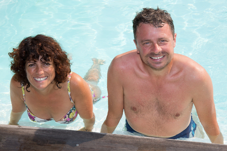 water aerobics: Couple, man and woman - doing sports and water aerobics