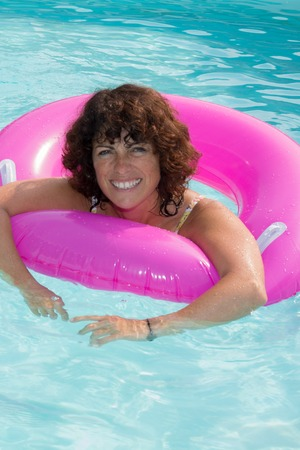 inner tube: Woman has a fun time on inner tube