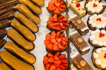 French pastries on display a confectionery shop or bakery Stock Photo