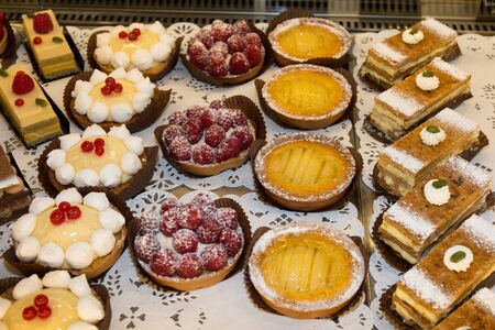 French pastries on display a confectionery shop or bakery