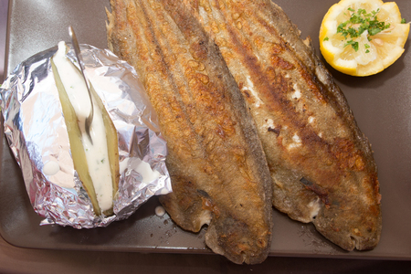 Grilled sole served with potatoes, a very Mediterranean recipe Stock Photo
